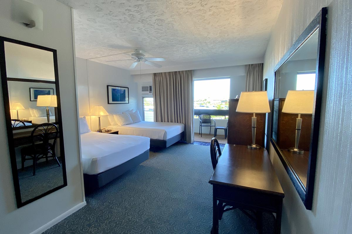 A hotel room with two beds